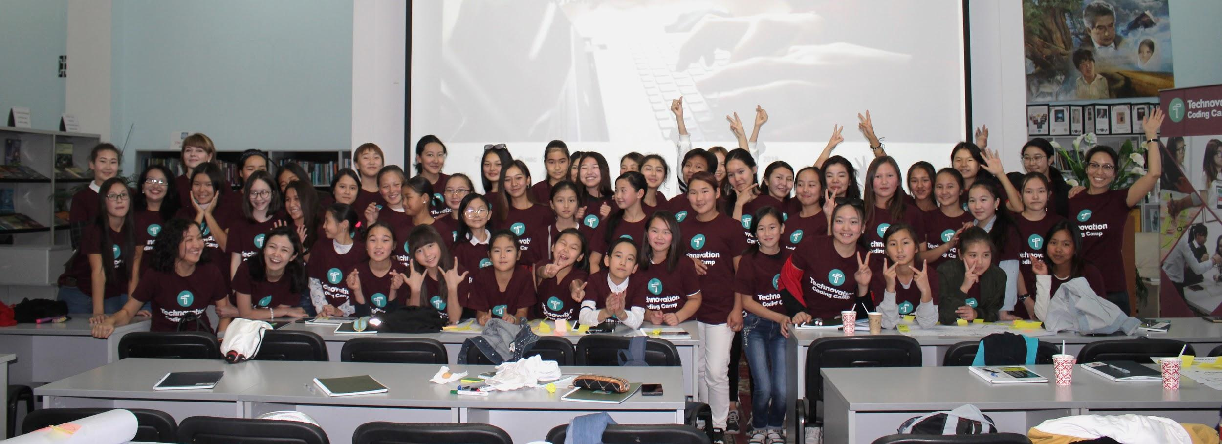 An enthusiastic class of young women---future innovators of technology