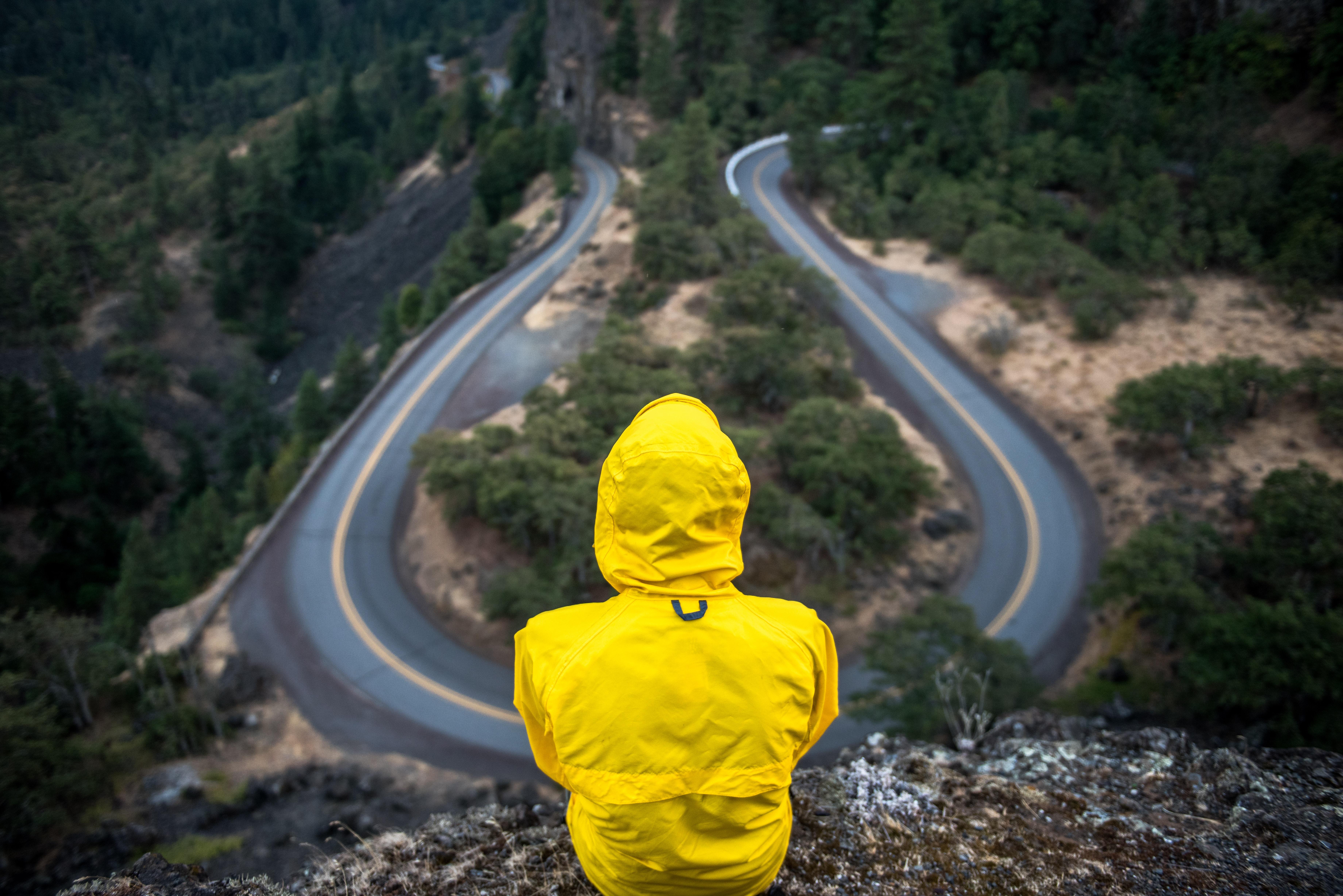 Photograph of a man at a crossroads