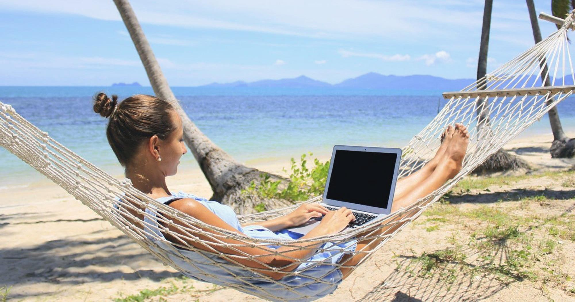 Digital nomad working on the beach.